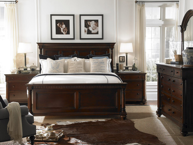 bedroom with wooden bed,chest of drawer and bedside tables