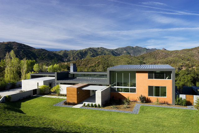 Modern exterior surrounded with green grass