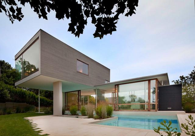 Modern glass pool house