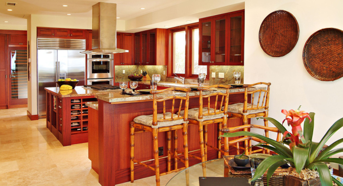 Tropical kitchen with wooden cabinets