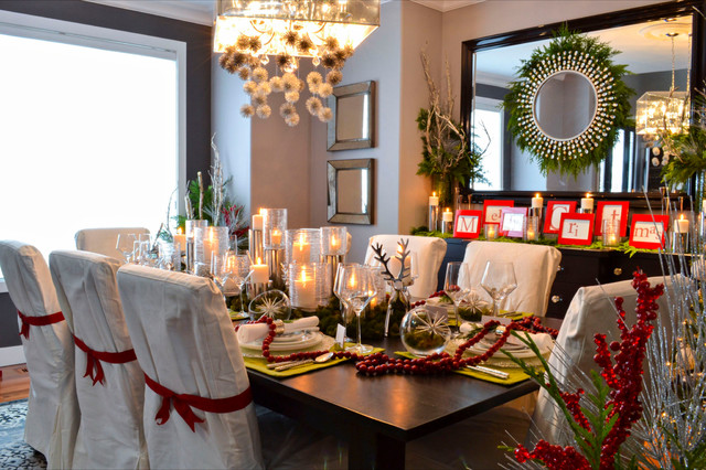 Dining room decorated with flowers, candles and garlands for Christmas