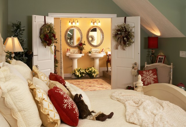 Wreaths on the doors and the splash of red in the room looks well balanced