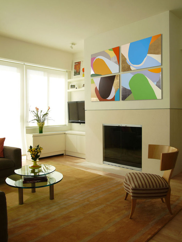 Electric fireplace is a great contrast to the artwork on the wall