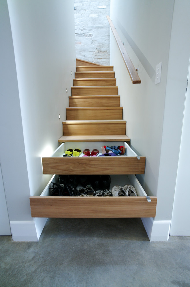 Shoes organizer designed below the stairs