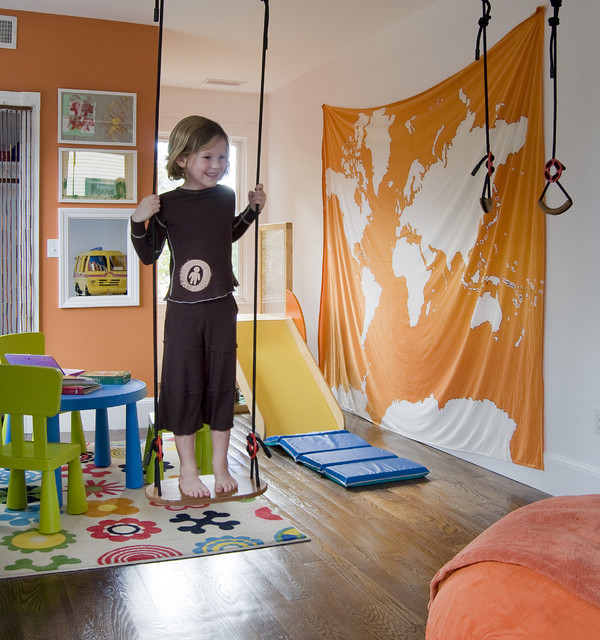 Play room with a swing