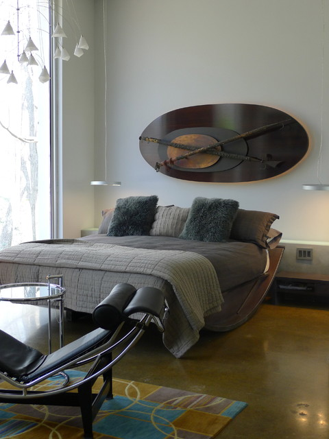 The bed is covered in shades and tones of grey