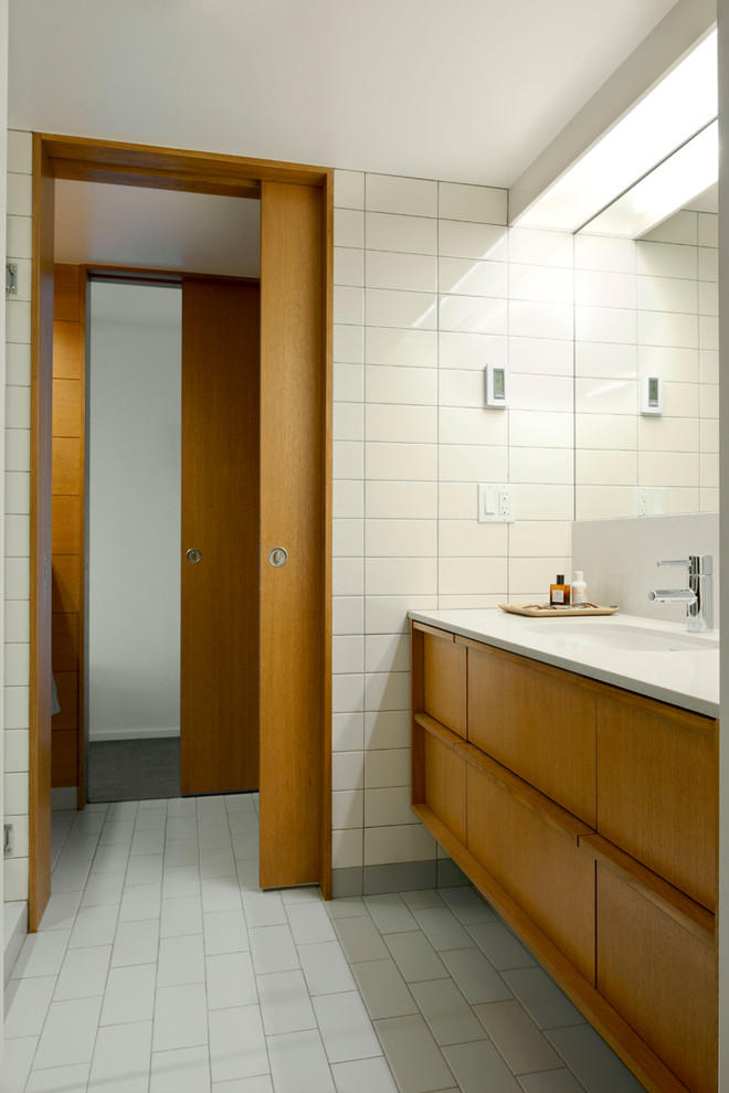 Wooden sliding door with silver metallic round knob