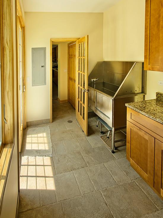 Yellow mud room with granite shelves
