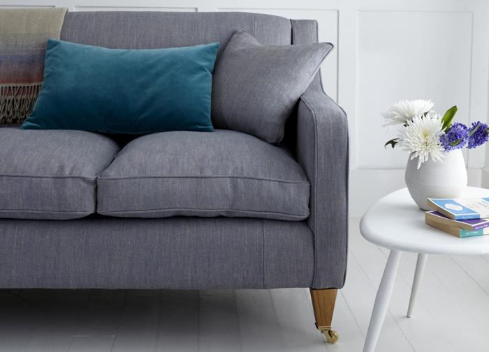 Big fat dark sofa dominates a fair share of the space
