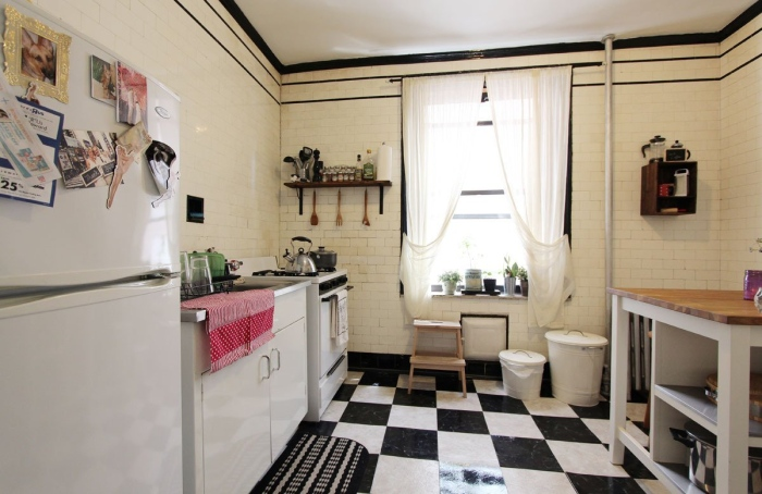 The checkerboard floor lends character to this kitchen