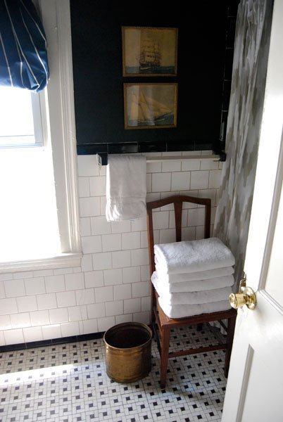 Bathroom with a wooden chair