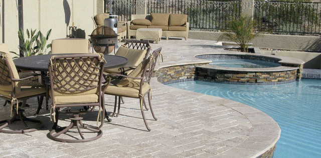 Gorgeous deck surface carries beautifully chiselled Tuscany beige travertine tiles