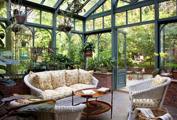 Conservatory surrounded by potted plants and flowers