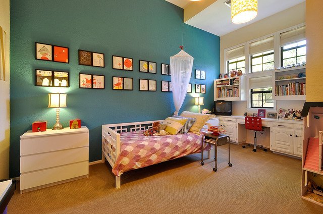 Kid's room with beige and blue walls.