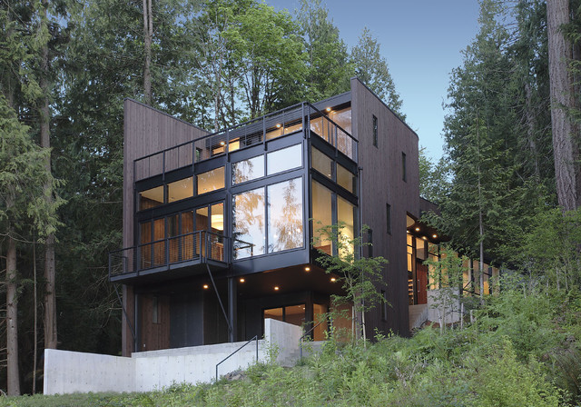 House exterior with great contrast of dark railings and wood siding