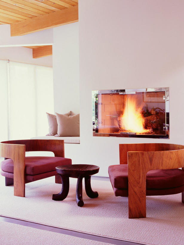 Electric fire encased in silver against a backdrop of a white fireplace