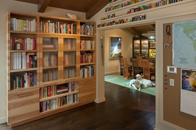 library done up in wooden furniture of high rising shelves
