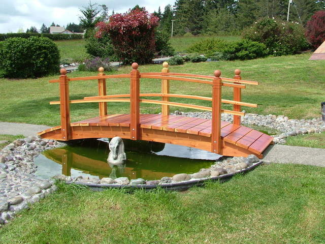 Red wood bridge over the water