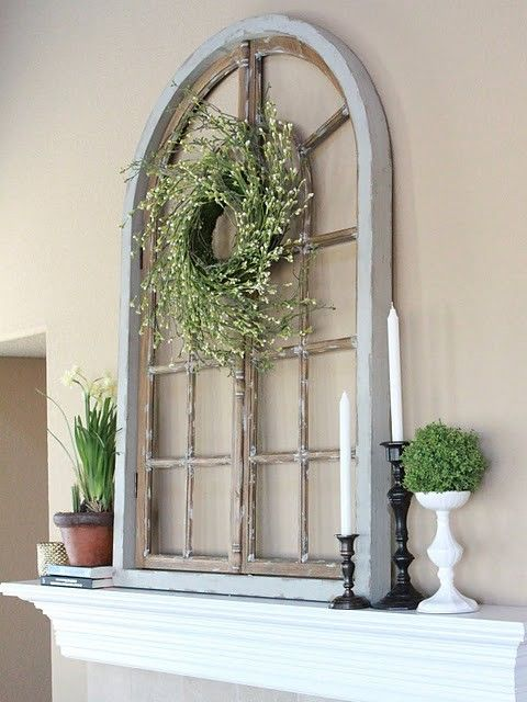 The window has been decorated with a ring of fresh flowers