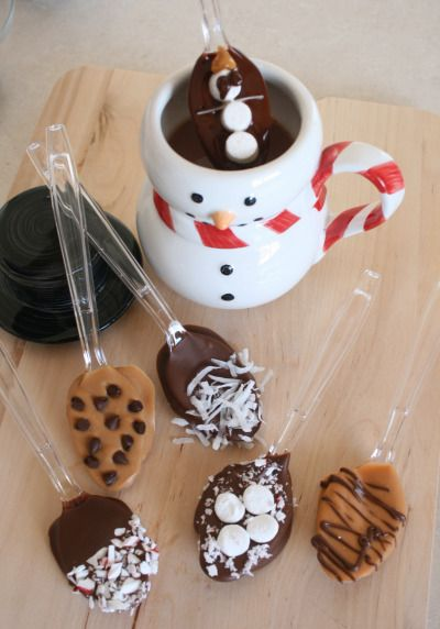 Plastic spoons decorate different kinds of chocolate