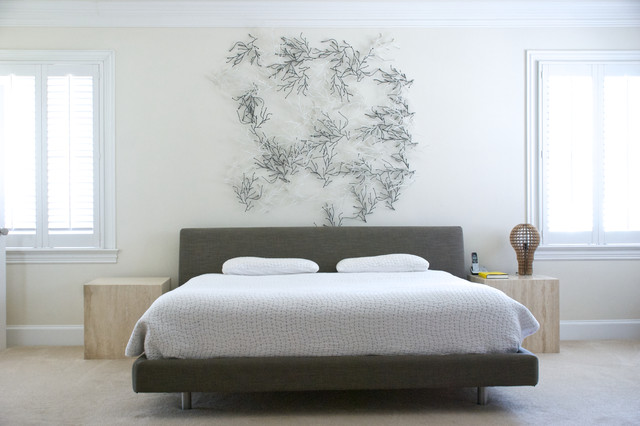 Bedroom with a metal sculpture