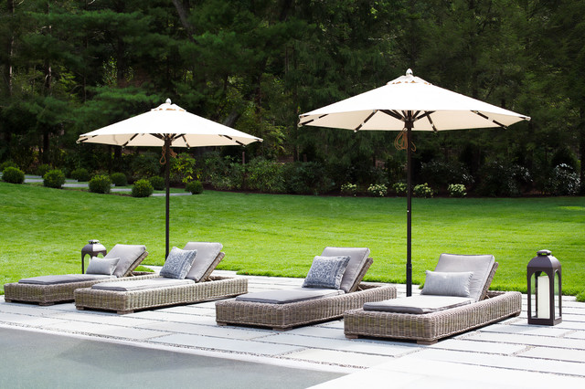 Pristine travertine pool decking area