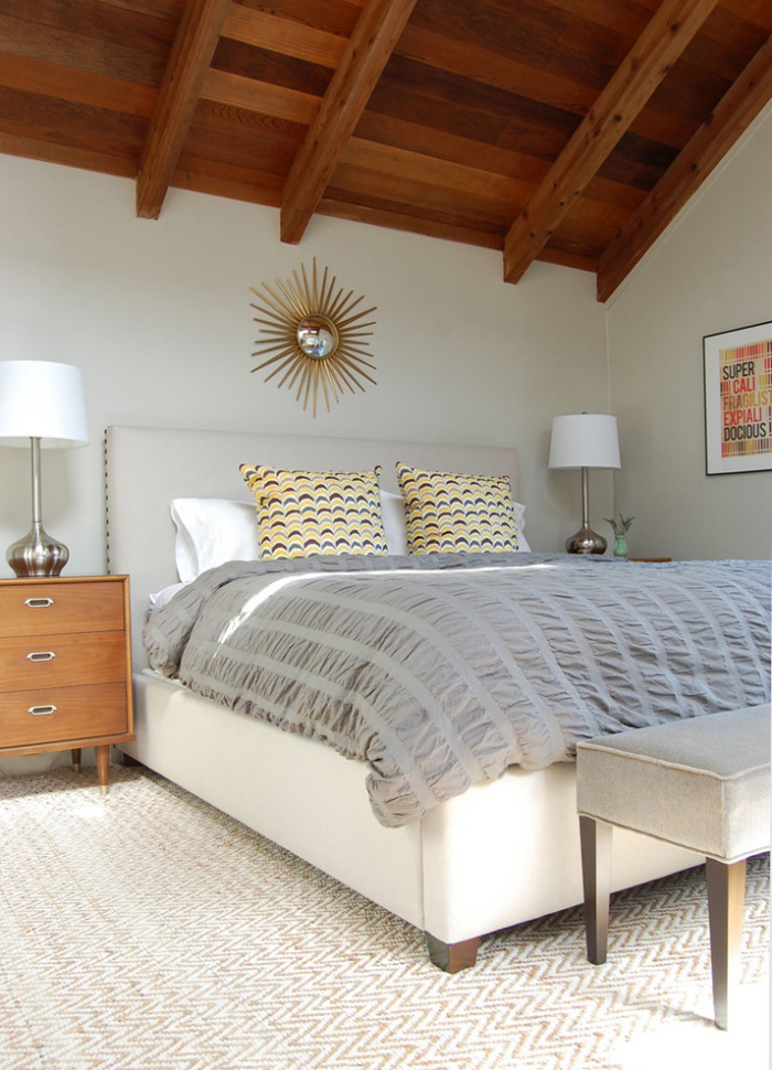 White upholstered bed has a fabric headboard