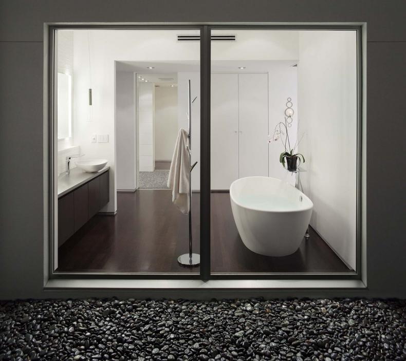Bathroom is seen behind glass doors