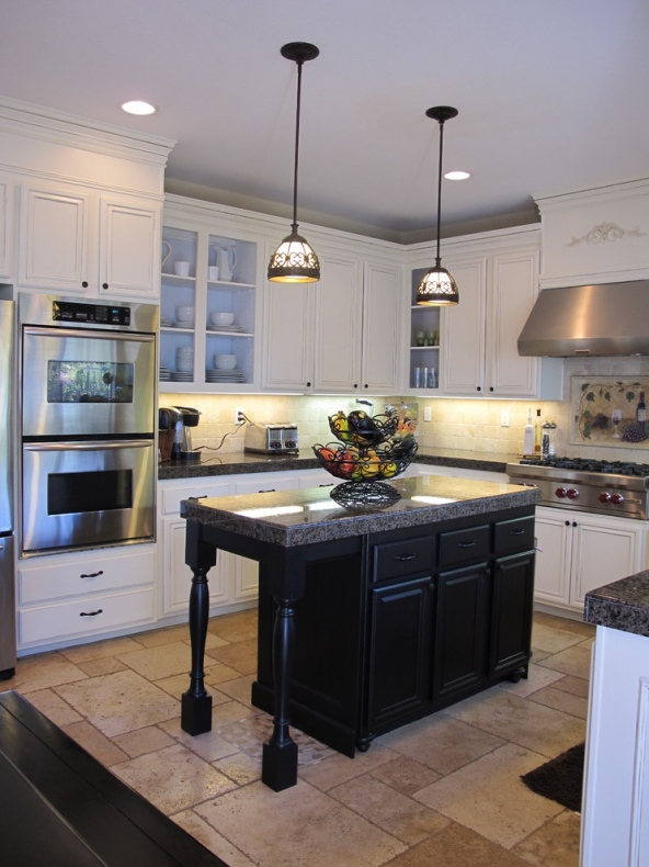 Style lighting fixtures hanging over classic black island