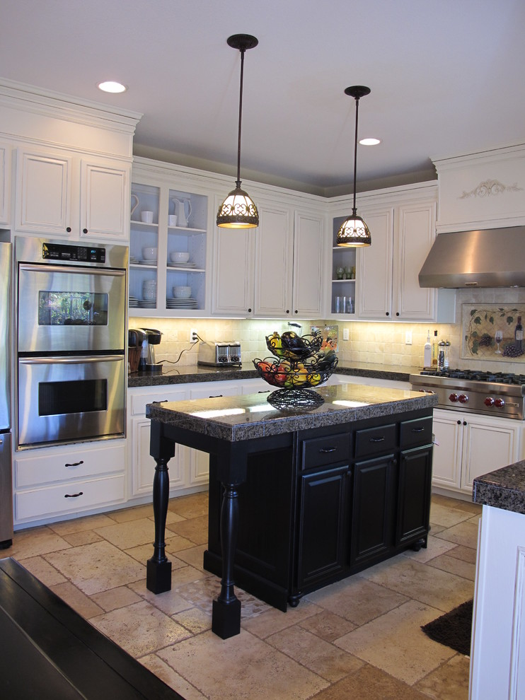Hanging lights over island in kitchen for Black kitchen cabinets small kitchen
