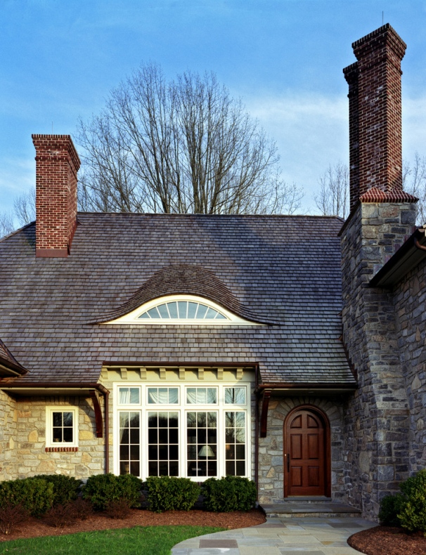 Traditional house features  a fixed glass Eyebrow dormer