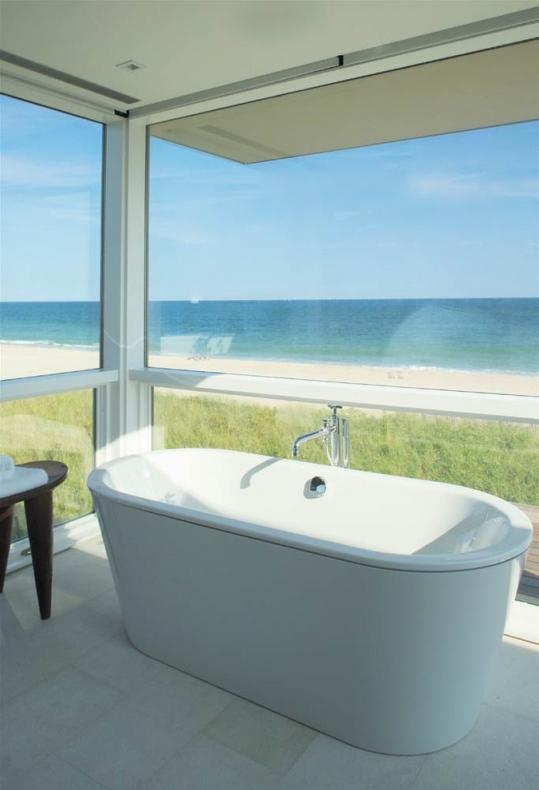 Bathroom with white ceramic tub