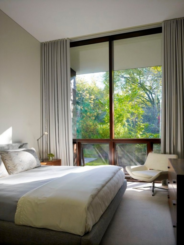 Curtains matches with the grey colour surface of the bed entirely