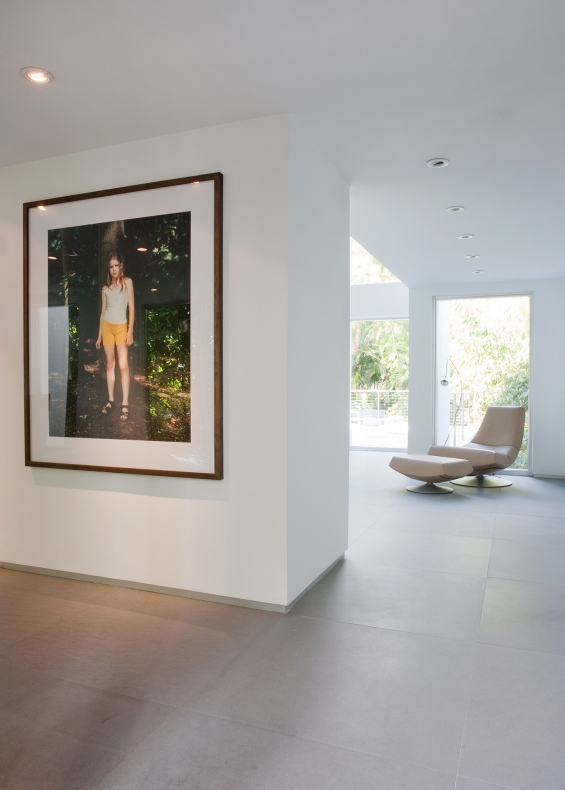 Portrait of a modern girl is hung in one wall