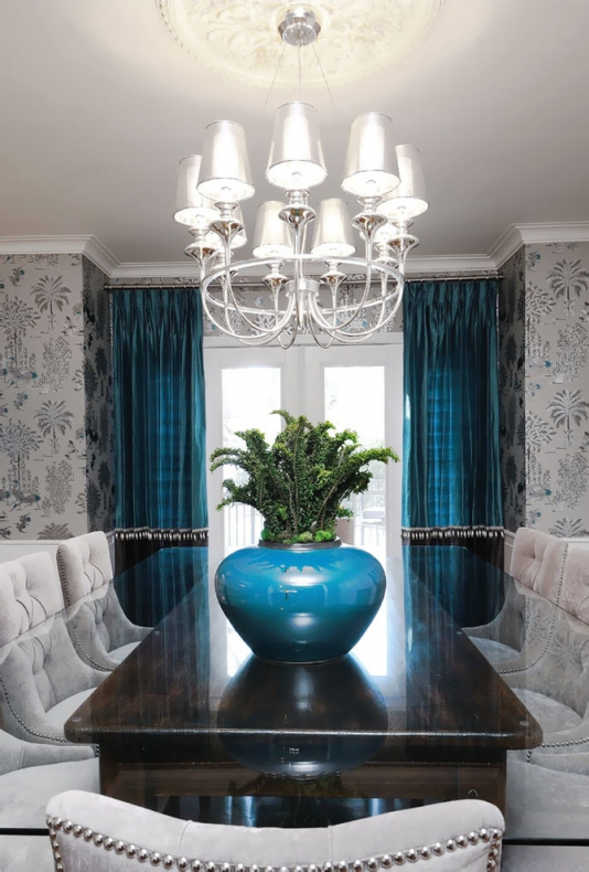 Dining room with blue curtains