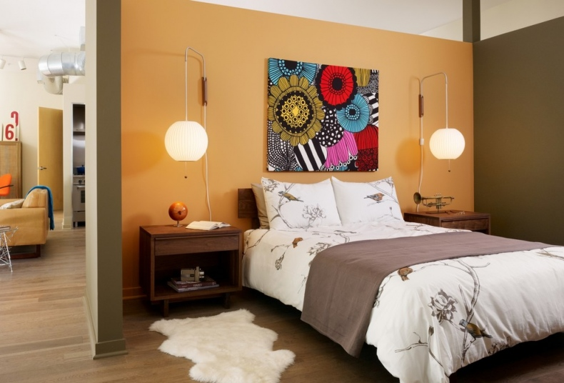 Plain sand-yellow bedroom wall with a painting