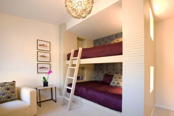 Bunk bed with a white ladder attached to the upper bed