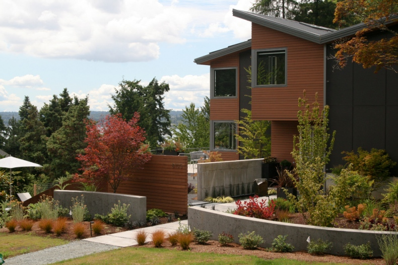 concrete walls, charcoal and brown cladding, grey aluminum window frames,