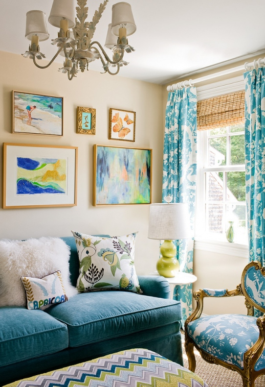 Sofa and printed blue and white chair matches with the curtains