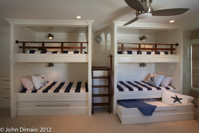 Double trundle beds side by side with a connecting ladder in between