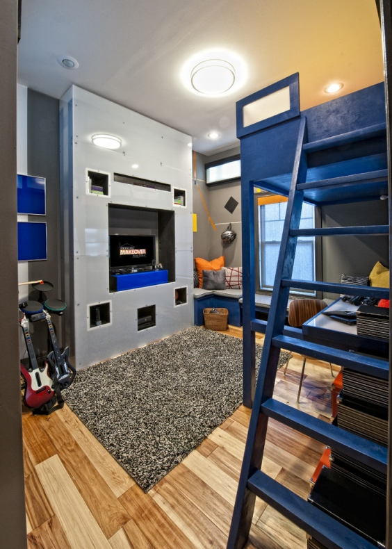 Small space blue bunk bed and desk