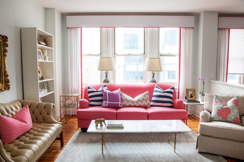 Sofas look natural matched with pink lining on the white curtains