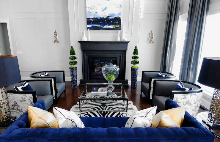 Royal blue sofa with grey and blue curtains