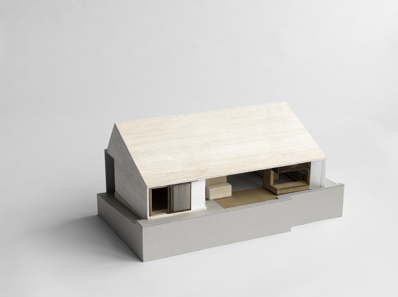 The model of the house is drawn on a white paper