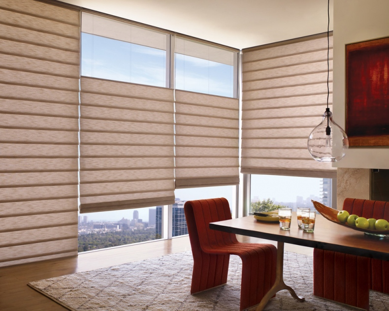 Paper like curtains which are blinds hangs over the glass windows