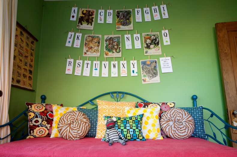 Uber green wall with alphabet hangings and animal pictures