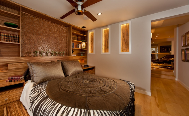 Brown bed spread and pillow covers complements the surrounding
