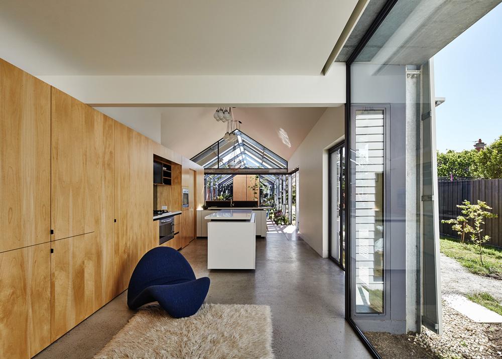 Living area with a blue elegant sofa
