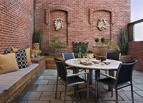 Balcony terrace has bold red brick walls