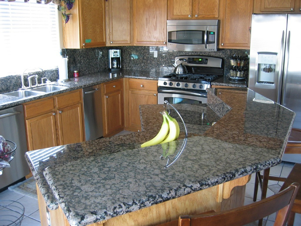 kitchens with gray granite countertops